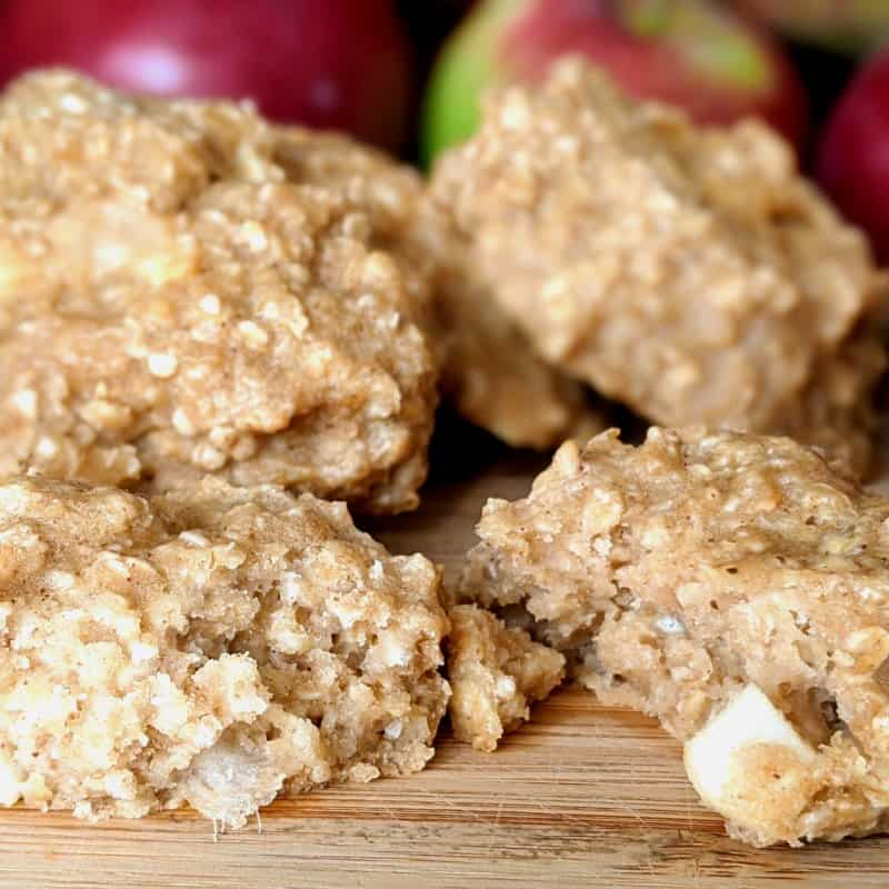 Delicious and kidney friendly oatmeal apple cookies with apples behind them.