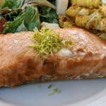 A chili lime salmon with a salad and roasted cauliflowers.