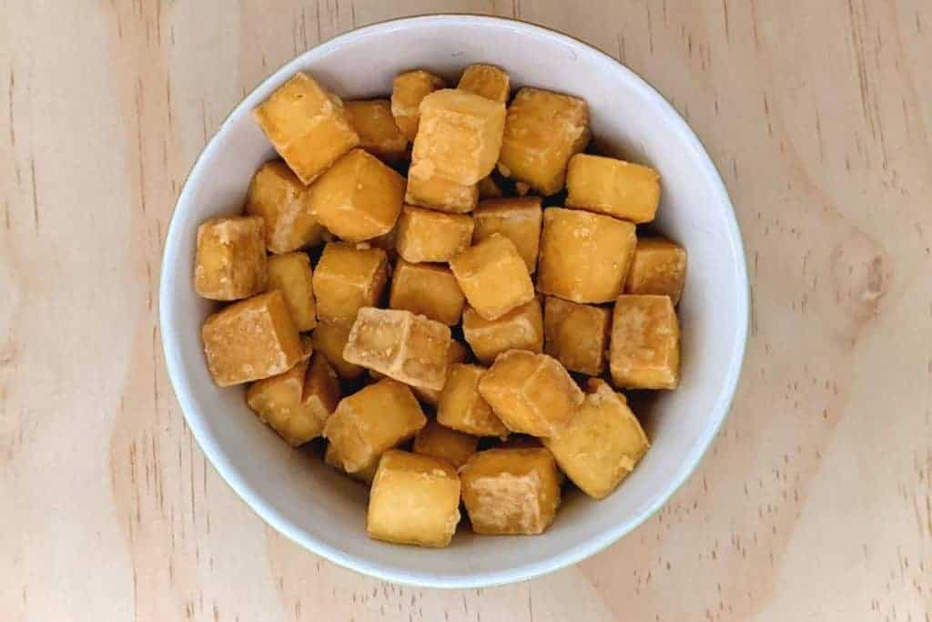 baked tofu ready to serve in a white bowl