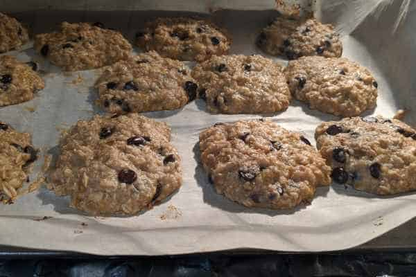 Chewy banana oatmeal chocolate chip cookies cooking in the oven.