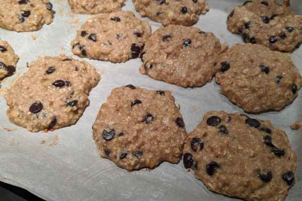 Chewy banana oatmeal chocolate chip cookies cooling right after cooking in the oven.
