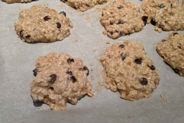 Banana cookie dough on parchment paper, 2 inches apart ready to put in the oven.