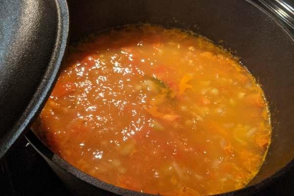 Split-pea soup simmering in a cast iron pot.