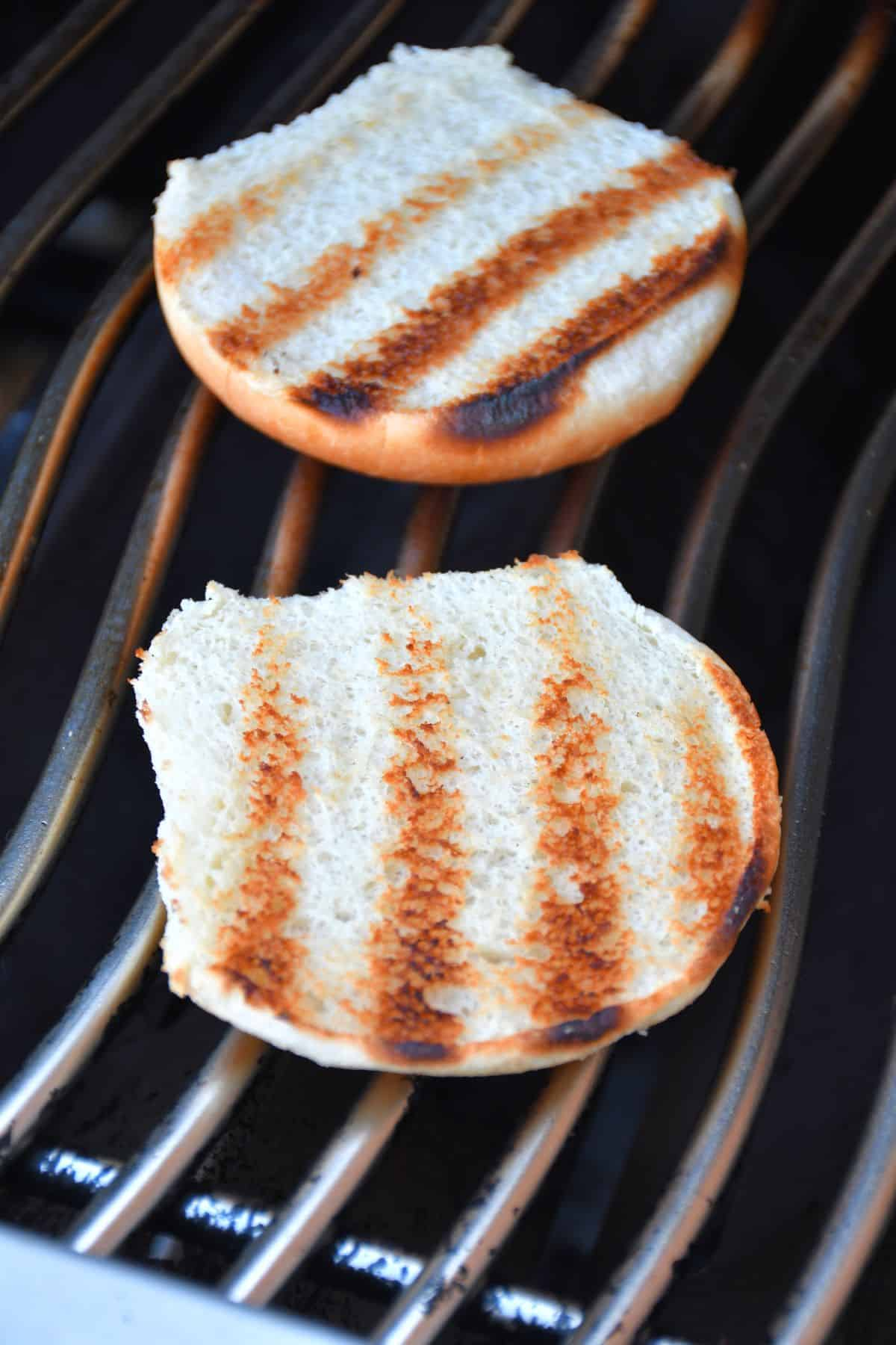 Grilled burger buns on the BBQ grid.